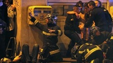 Firefighters pull hostages from the Bataclan music venue after the attack