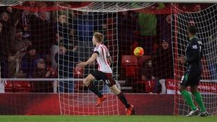 Watmore celebrates his goal.