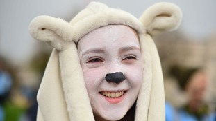 A young campaigner dressed as a polar bea