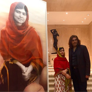 Malala Yousafzai with artist Nasser Azam at the unveiling of a new portrait entitled Malala, at the Barber Institute of Fine Arts, Birmingham