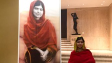Malala Yousafzai with her portrait