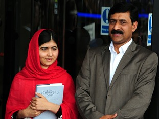 Malala with her father Ziauddin Yousafzai, as she officially opened the Library of Birmingham in the city centre