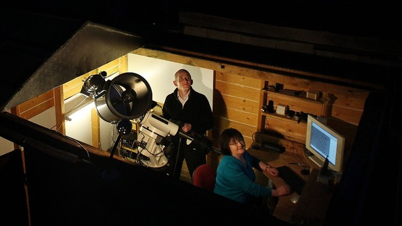 Dave Grennan and his wife Carol in their back garden observatory
