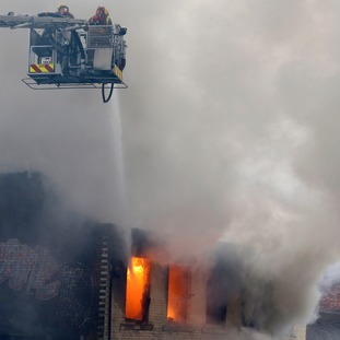 Firefighters tackle the blaze from on high.