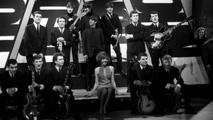 Cilla Black (c) with The Beatles (back) and other bands at a rehearsal in 1963. C