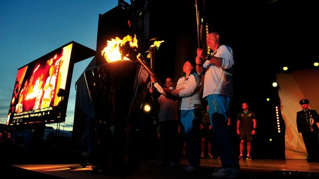 The flames unite to light the Paralympic Cauldron
