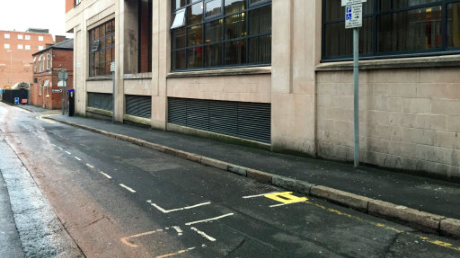 Two-foot long double yellow lines painted in city centre ...