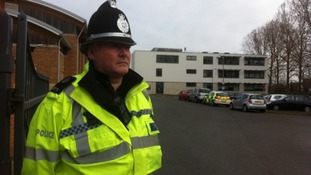 Police guard the school gates at Baxter College where Luke Chapman collapsed and died