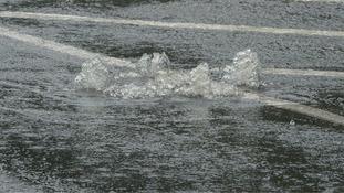 Water bubbling up through drain