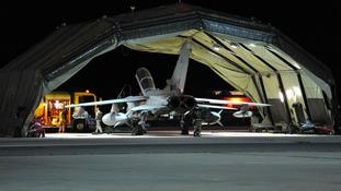 Ground crew work on a RAF Tornado GR4.