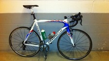 This is a replica of the stolen bicycle described as being a Pinarello Paris - it is red, white and blue. It also has Mr Hindes' name on.