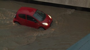 Flood waters from a burst pipe caused huge delays in Plymouth.