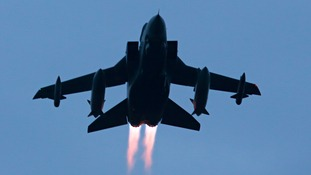 What did the region's MPs say in Parliament about airstrikes in Syria?
