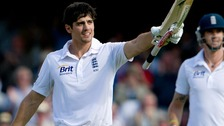 England's Alastair Cook reaches his 100 during the first day of the first cricket test match against South Africa