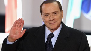 Silvio Berlusconi leaves the conference centre after the first day of the G20 Summit in Cannes in 2011