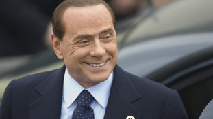 Silvio Berlusconi arrives for an evening dinner function at the G8 summit in Deauville in 2011