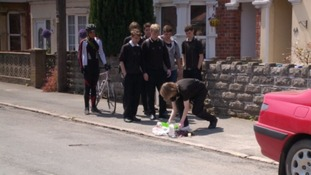 Daniel's friends lay flowers at the scene of his death.