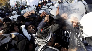 Migrants scuffle with Greek police at the border with Macedonia