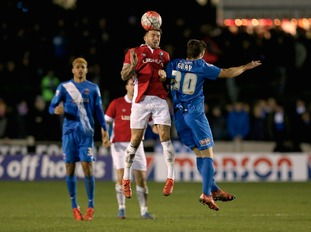 Salford City's Scott Burton (left) and Hartlepool United's Jake Gray battle for the ball