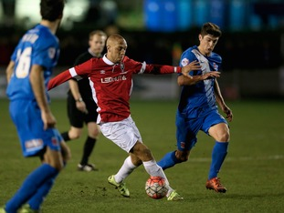 Salford City's Richie Allen (left) and Hartlepool United's Jake Gray battle for the ball