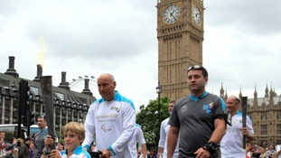 Edward Parker and Torchbearing team 78 carry the Paralympic Flame