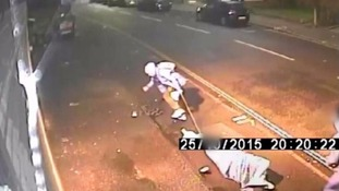 Pensioner knocked to the floor and dragged along pavement by bag snatcher