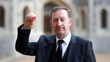 Huw Jenkins collecting an OBE from Buckingham Palace