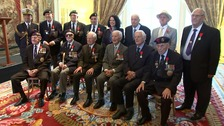 12 British military veterans were awarded France's highest military honour