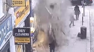 Dramatic footage shows roof collapsing onto shoppers on busy street