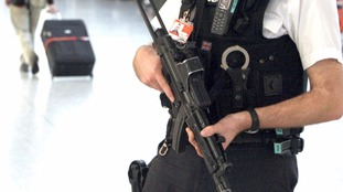 An armed police officer on patrol