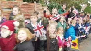Schoolchildren in Warminster lined the streets outside a charity the Duchess of Cambridge has been visiting today.