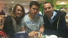 Oliver Lilburn, centre, with his parents Justine and Colin
