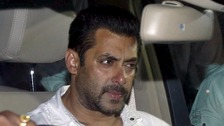 Bollywood actor Salman Khan sits in a car as he leaves a court in Mumbai