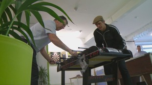 Two men playing table top football.