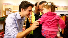 Canadian prime minister Justin Trudeau greeted Syrian refugees at Toronto airport