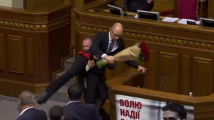 Ukraine MP grabs Prime Minister and sparks huge brawl during parliamentary debate