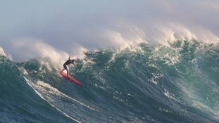Surfer from Devon conquers one of the world's biggest waves