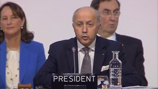 Laurent Fabius outlines sections of the agreement in Paris.