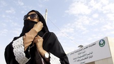 A Saudi woman leaves a polling station