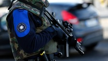 Two Syrians held in Switzerland over terror links.