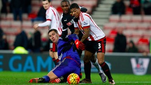 Watford's Odion Ighalo (centre) battles for the ball with Sunderland's Patrick Van Aanholt and goalkeeper Costel Pantilimon.
