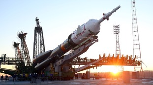The 162-ft long Soyuz FG rocket is manoeuvred into position.