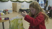 Khia Powell collecting for Cumbrian flood victims.