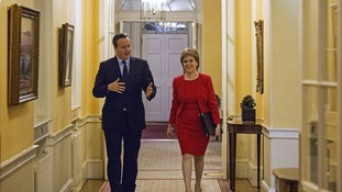 British Prime Minister Cameron walks with the First Minister of Scotland Sturgeon