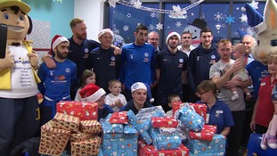 The Peterborough United players visit the hospital yesterday.