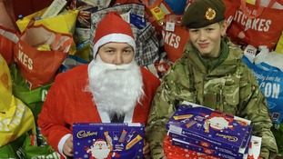 Santa's little soldiers deliver sweets to children affected by the floods across Cumbria