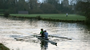 Rowers on the river Cam in Cambridge.