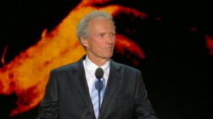 Clint Eastwood interviews an invisible Barack Obama