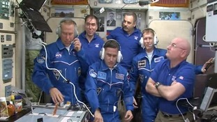 The whole crew assemble on the International Space Station.