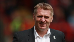 Dean Smith left Walsall soon after agreeing a new contract with the club.